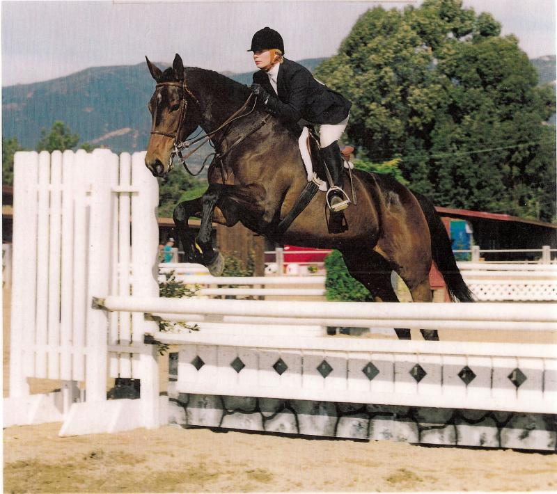 Stephanie Jumping Frankie in Santa Barbara, California